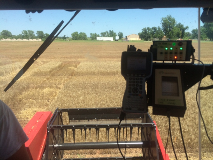 The view from the driver seat of the Massey 8XP, with the Harvest Master on the right.